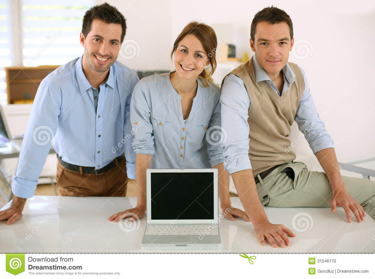 Business team showing text or results on laptop screen