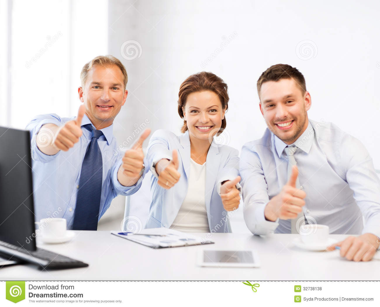 Business Team Showing Thumbs Up In fice Royalty Free #0: business team showing thumbs up office friendly