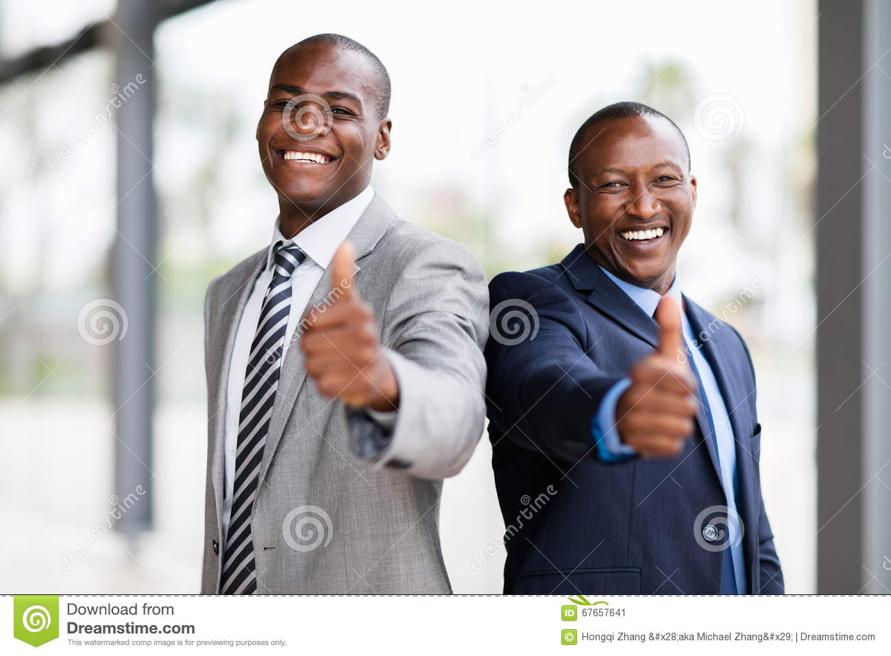 business team thumbs up