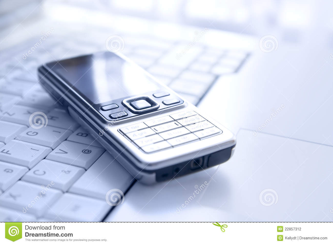 Business technology concept mobile phone over keyboard of a luxury