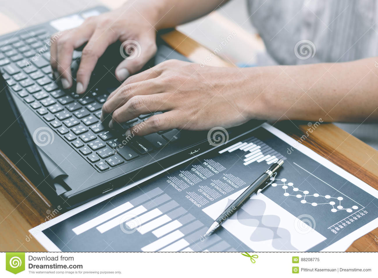 business technology concept,Business people hands use smart phone and laptop for business analyst project on table