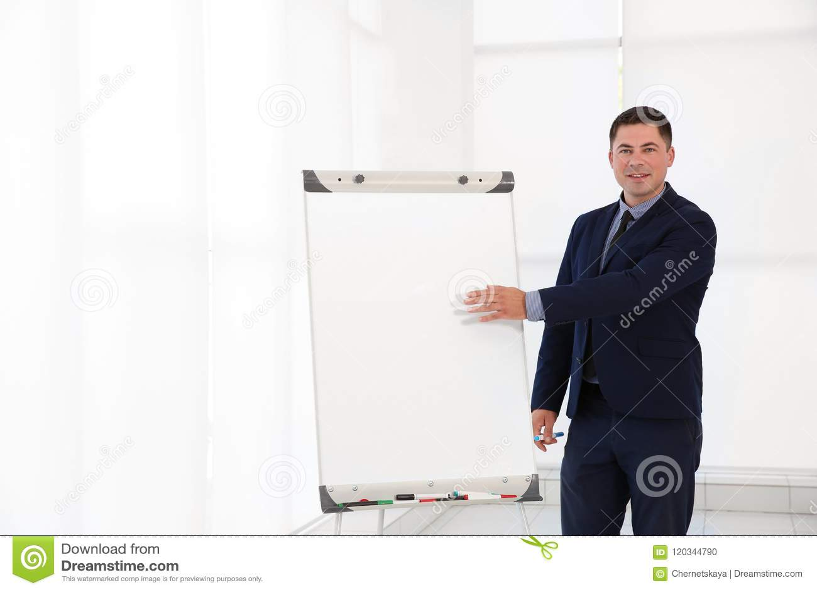Business trainer giving presentation