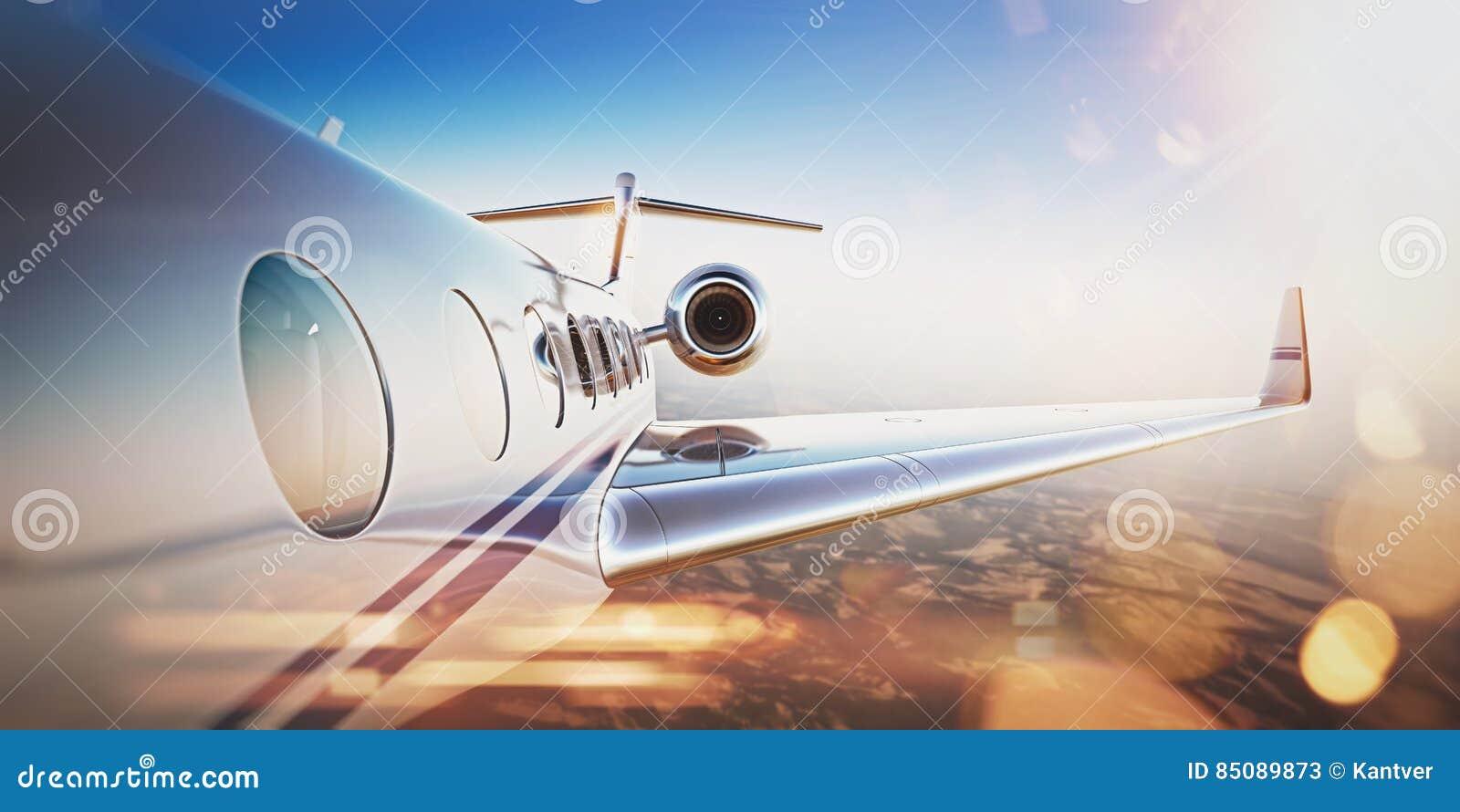 Business travel concept.Generic design of white luxury private jet flying in blue sky at sunset.Uninhabited desert