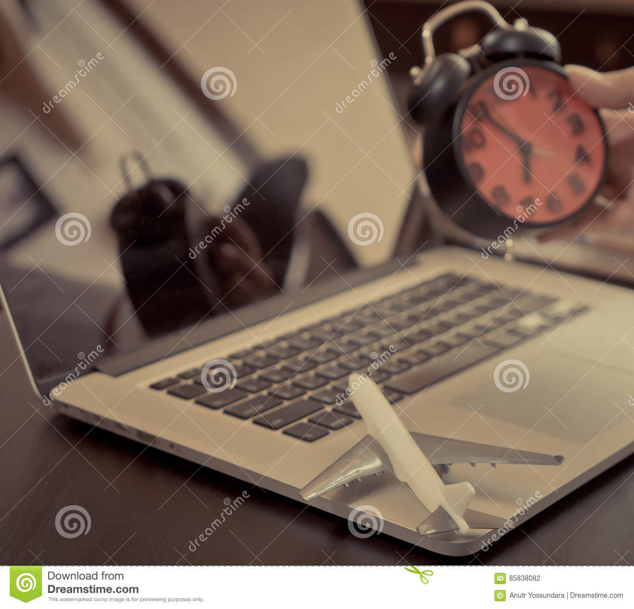 Business travel time holding alarm clock