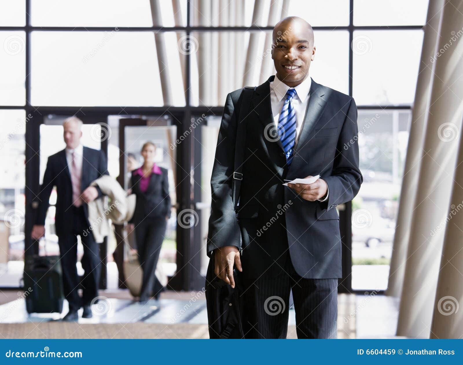 Business traveler holding briefcase, passport