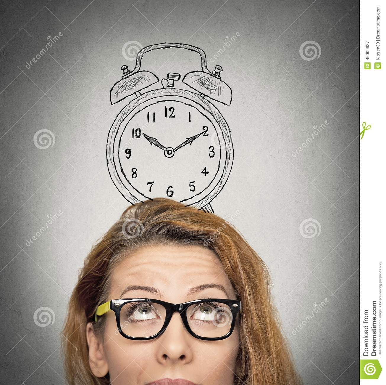 Business woman with alarm clock above her head