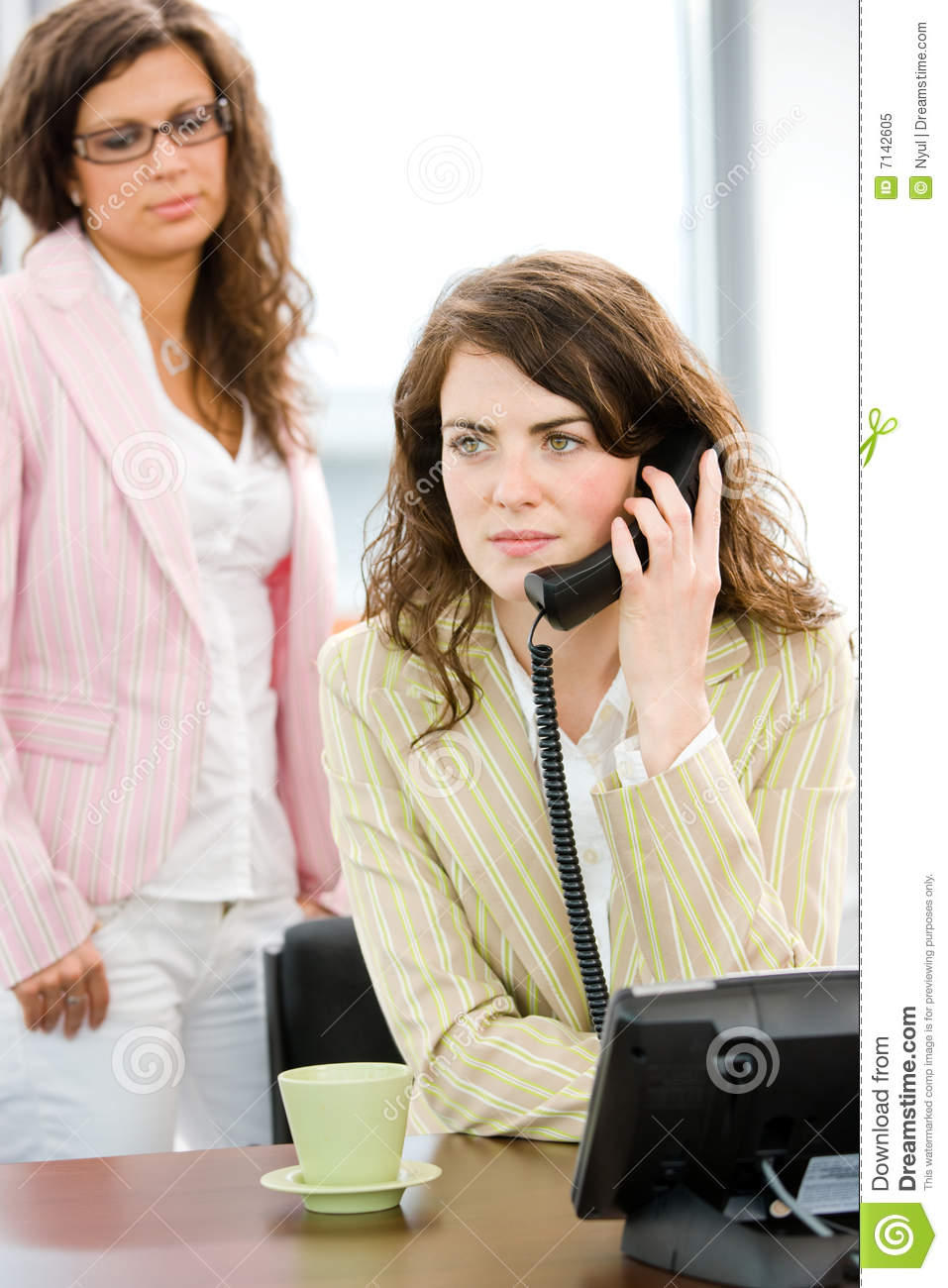 Business woman calling on phone