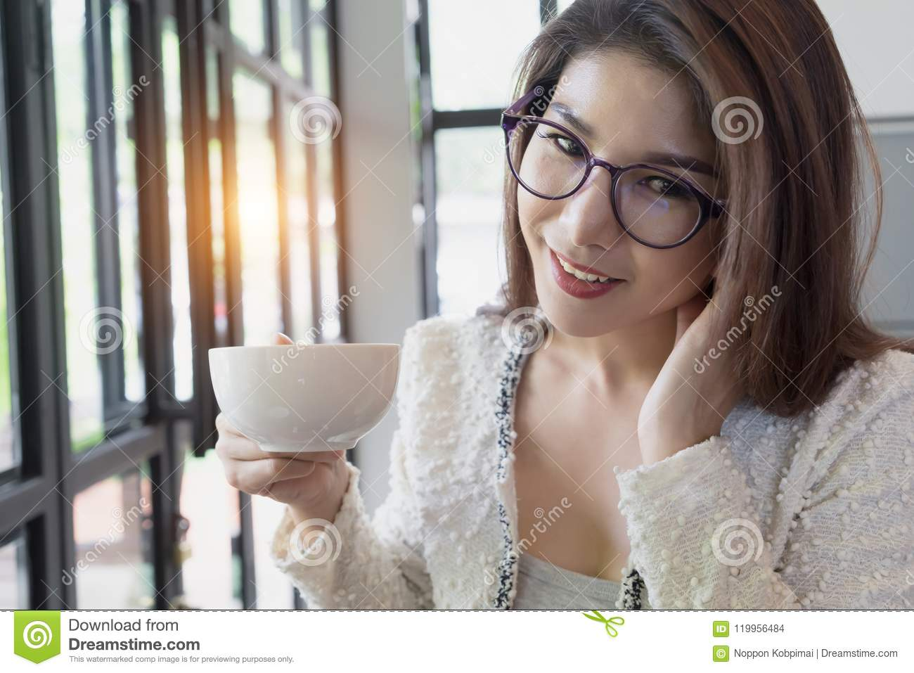 Business woman drinking coffee. Happy young girl holding tea cup