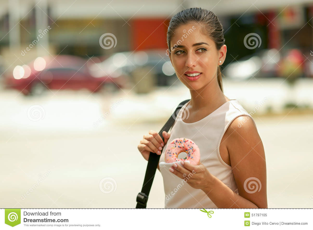 Business Woman Eating Donut For Breakfast Commuting To Work Stock
