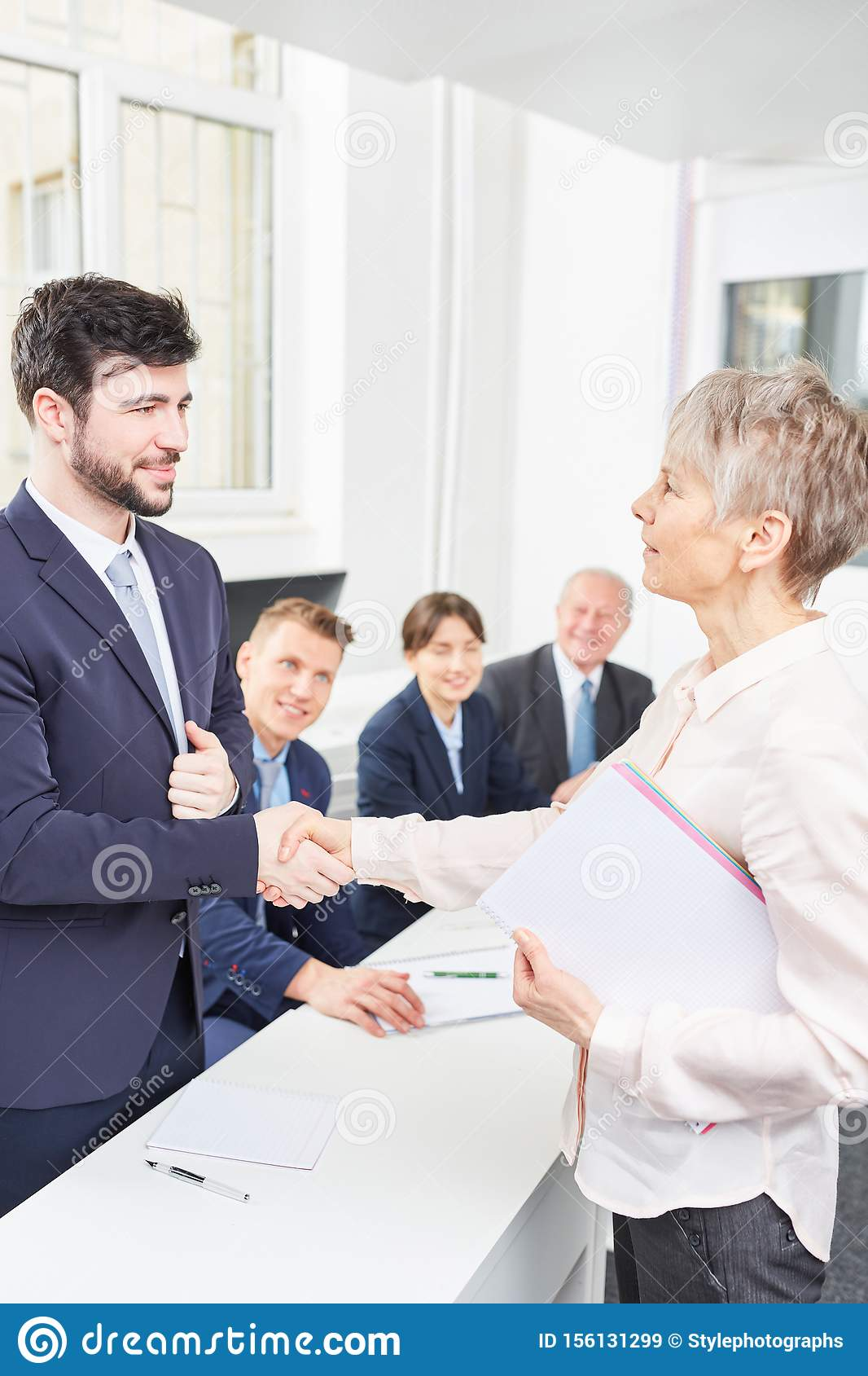 Business woman gives candidate handshake
