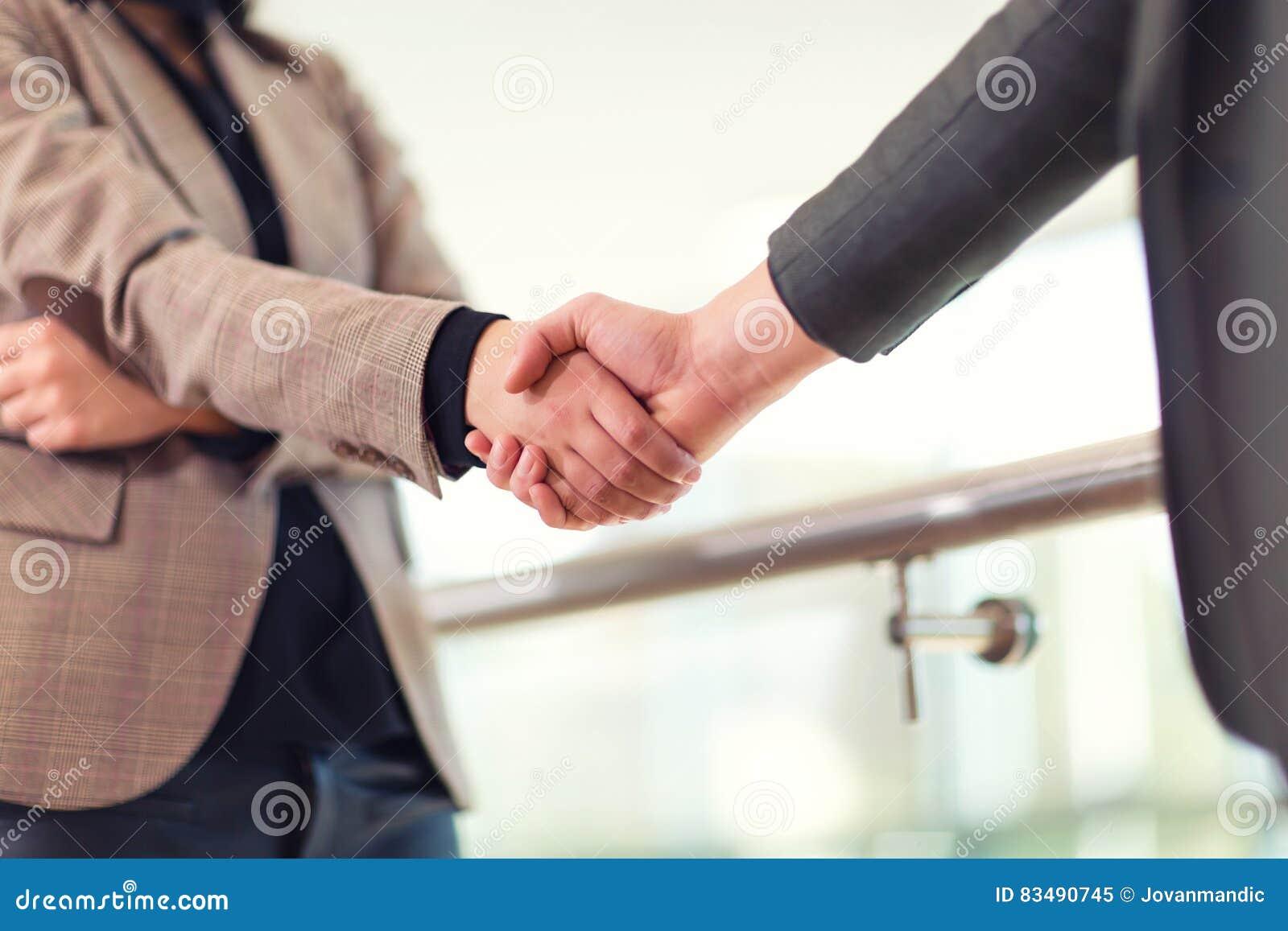 Business woman giving a handshake