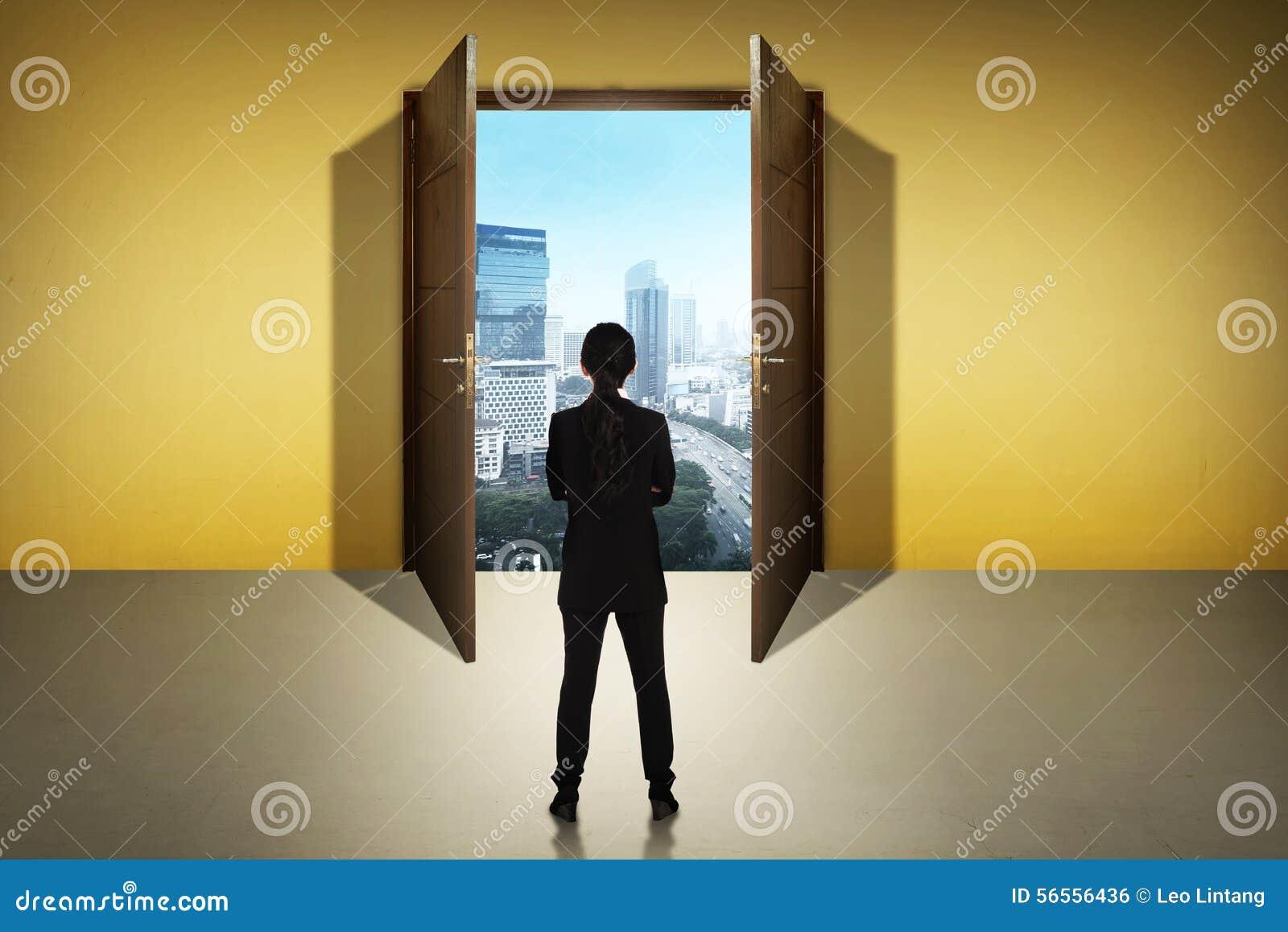 Girl Walks Into Door : Woman walking into bright door stock photo cartoondealer