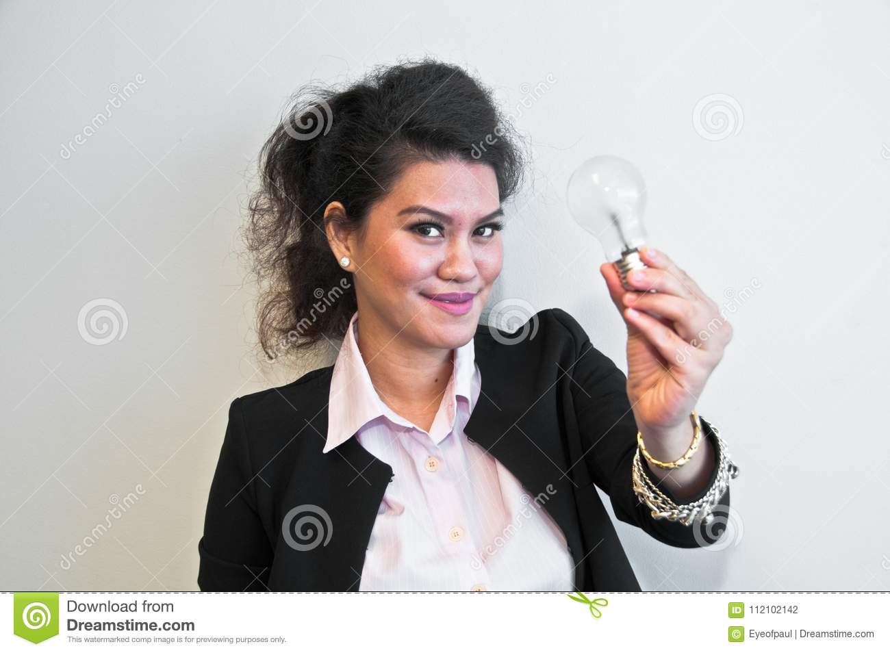 business woman hold light bulb on white background stock photo