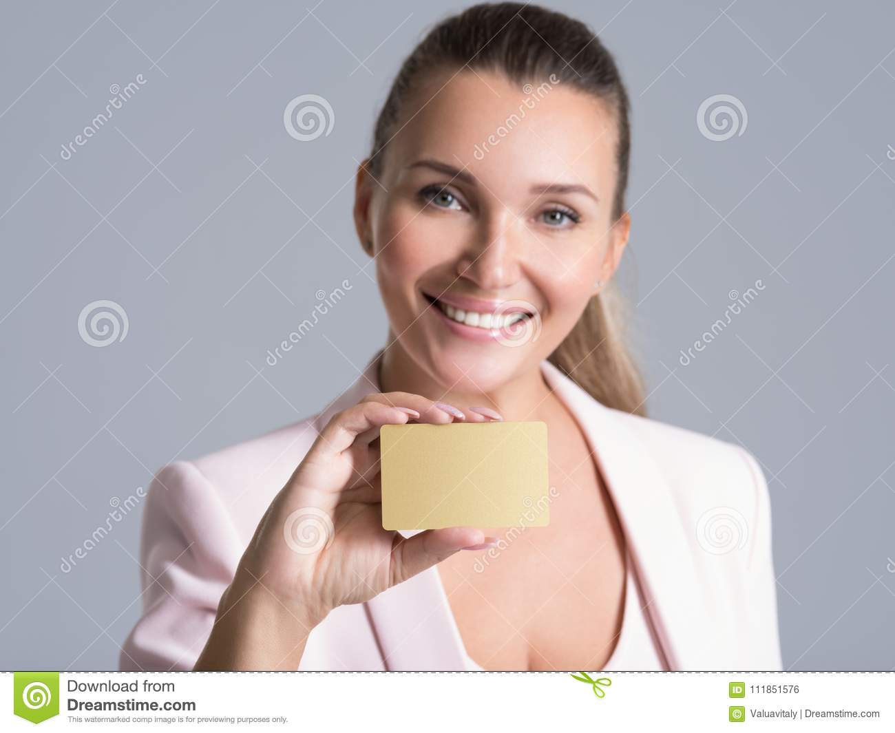 Business woman holding credit card against her face isolated