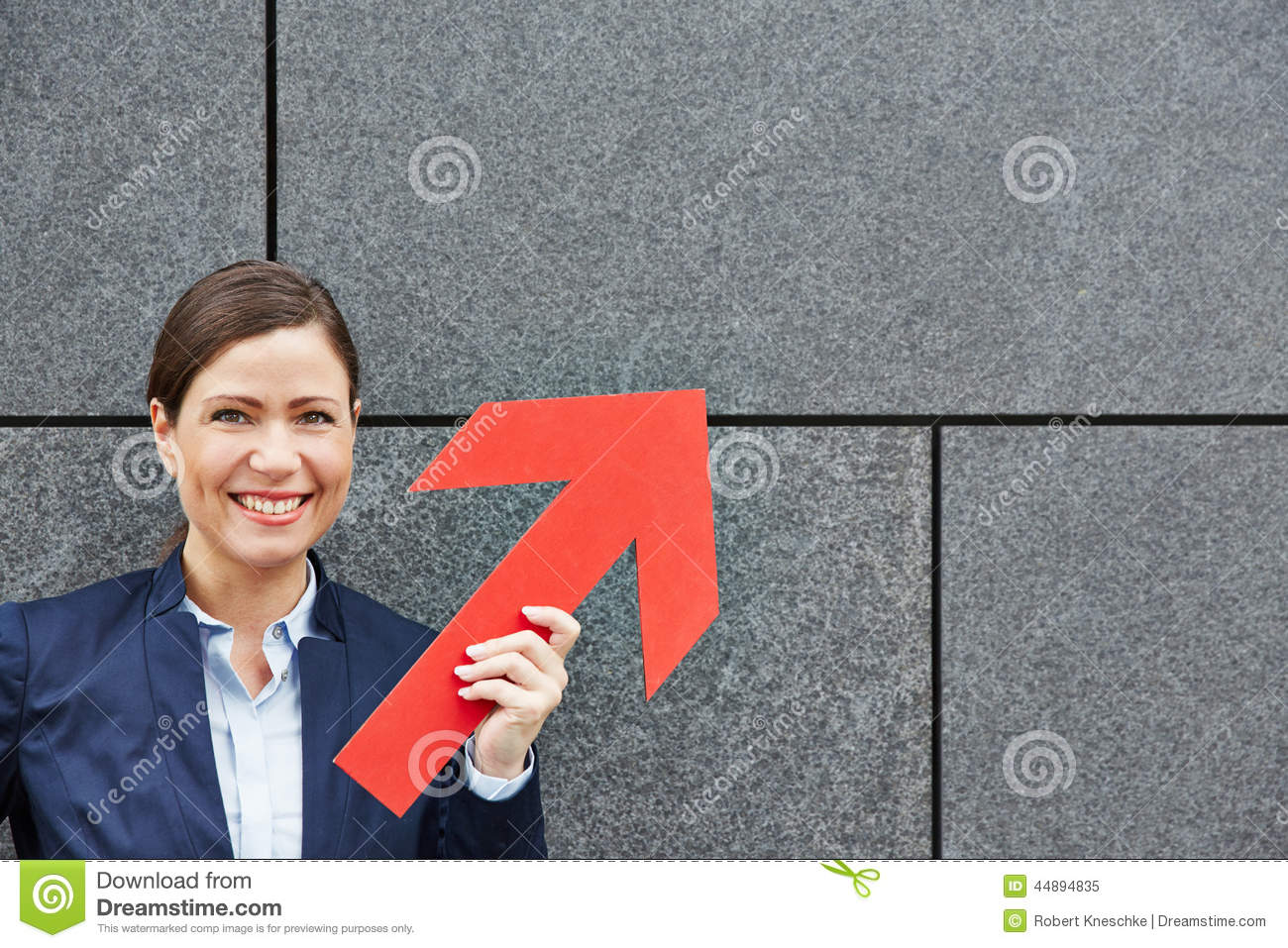 Business woman holding red arrow up