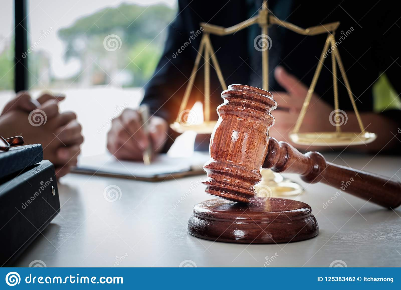 Business woman and lawyers discussing contract papers with brass scale on wooden desk in office. Law, legal services, advice, Just