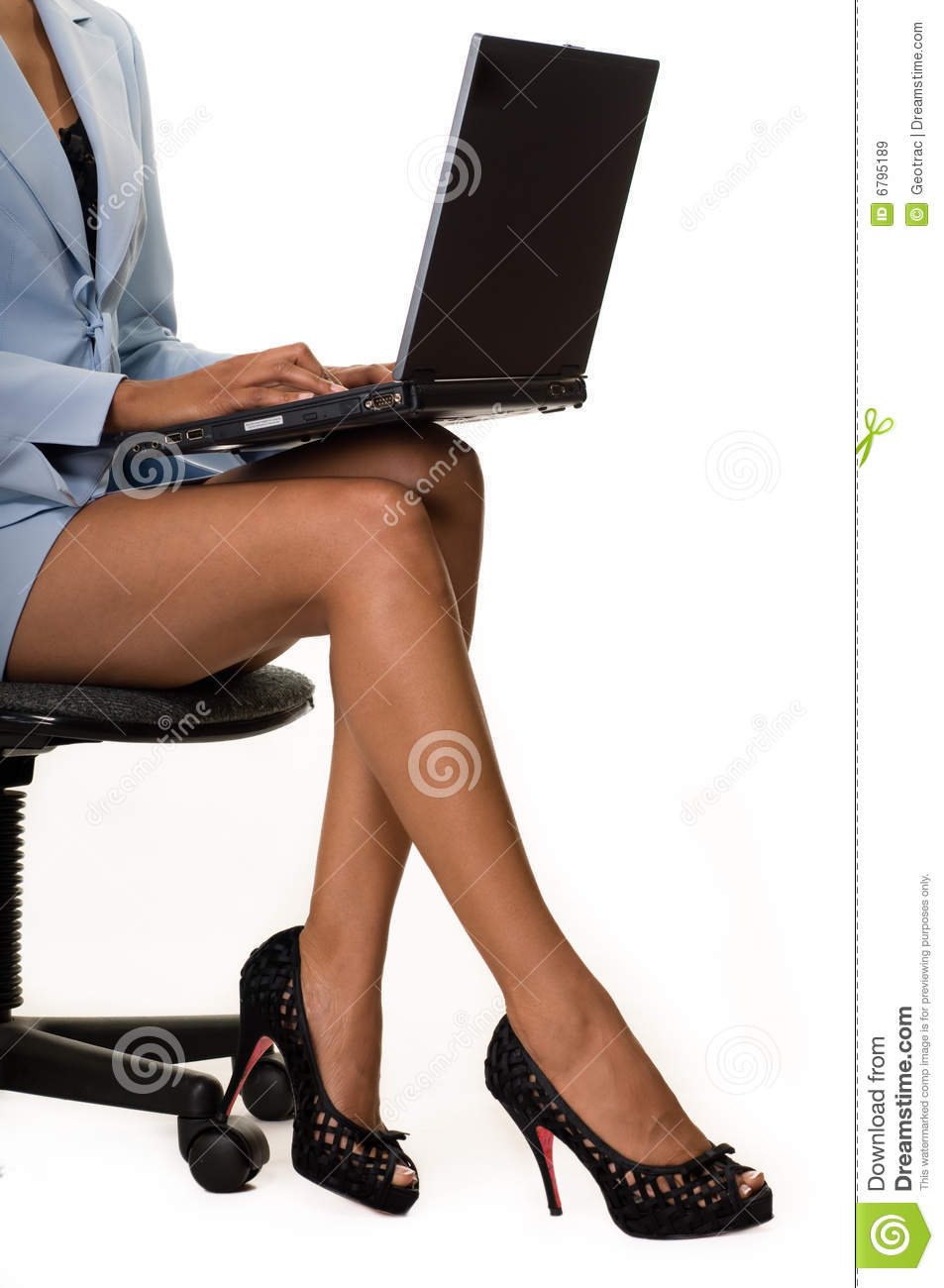 Legs of business woman sitting on a chair holding a laptop computer on ...