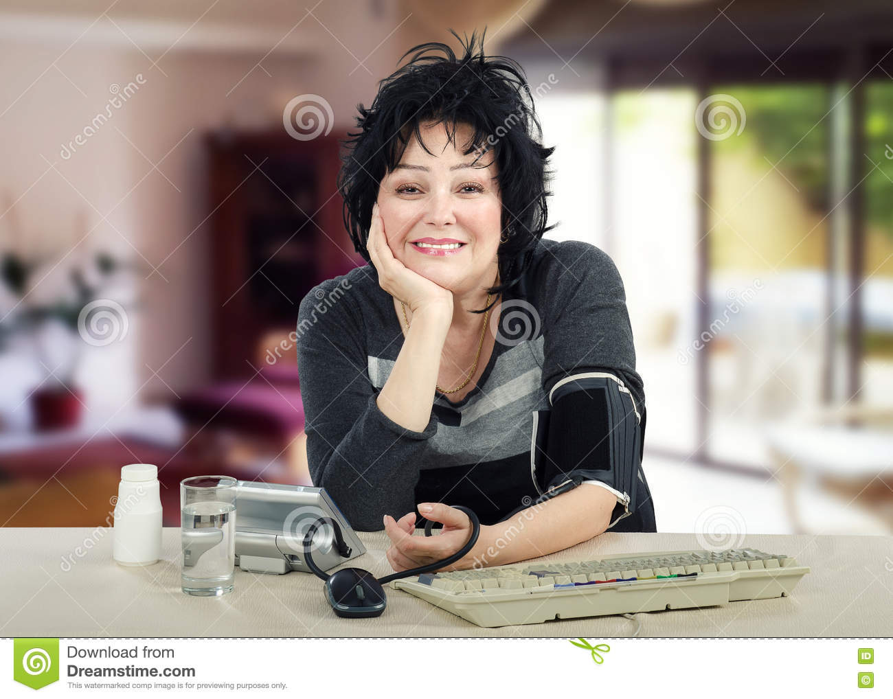 business woman likes to take her blood pressure stock photo - image