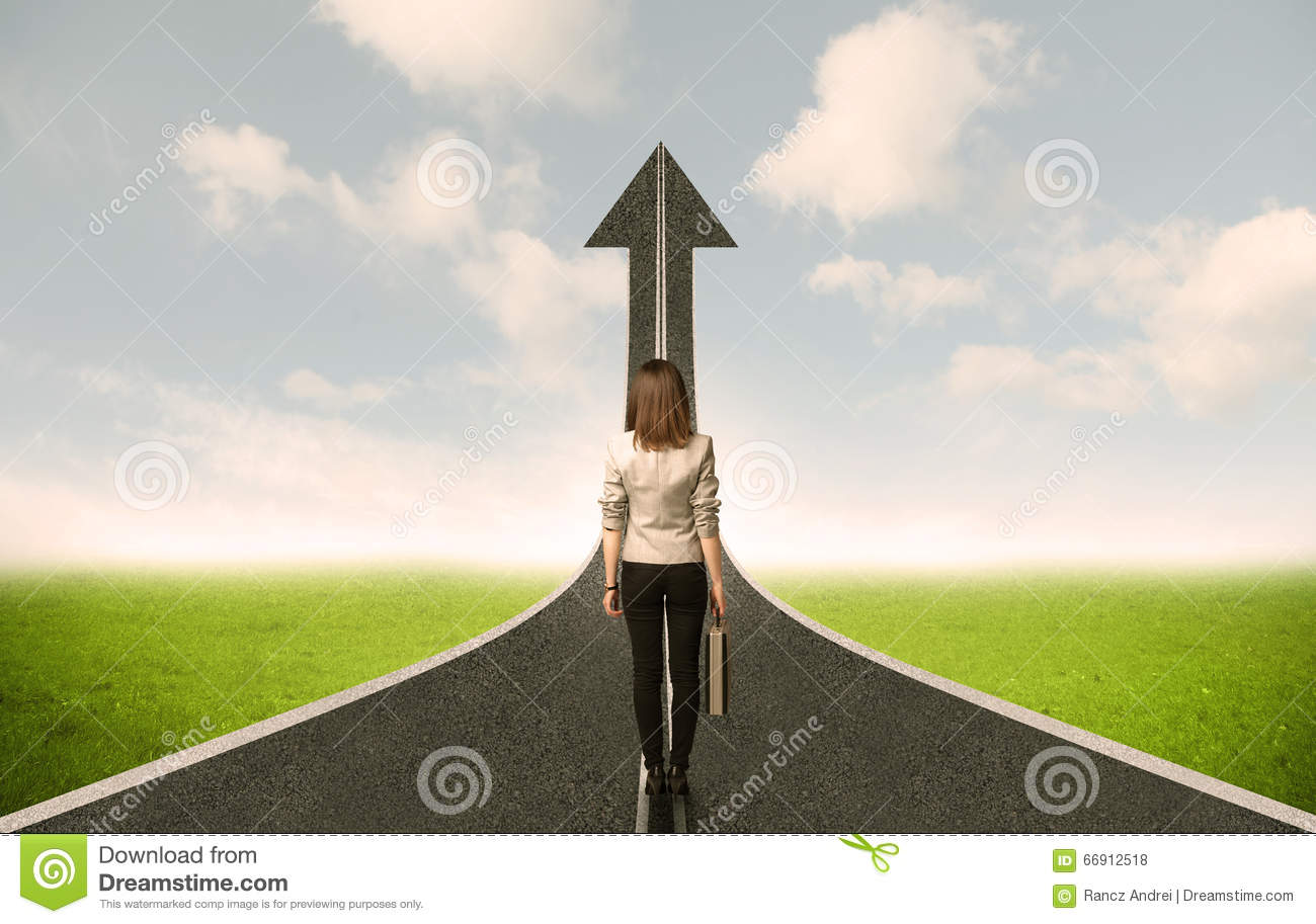 Business woman lokking at 3d road with up arrow