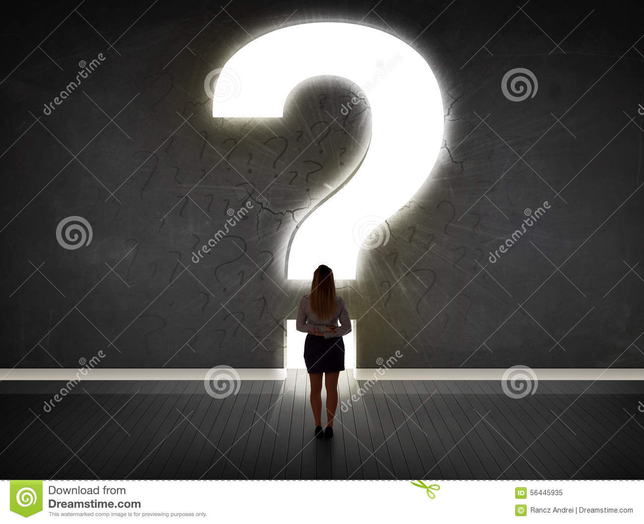 Business woman looking at wall with a bright question mark