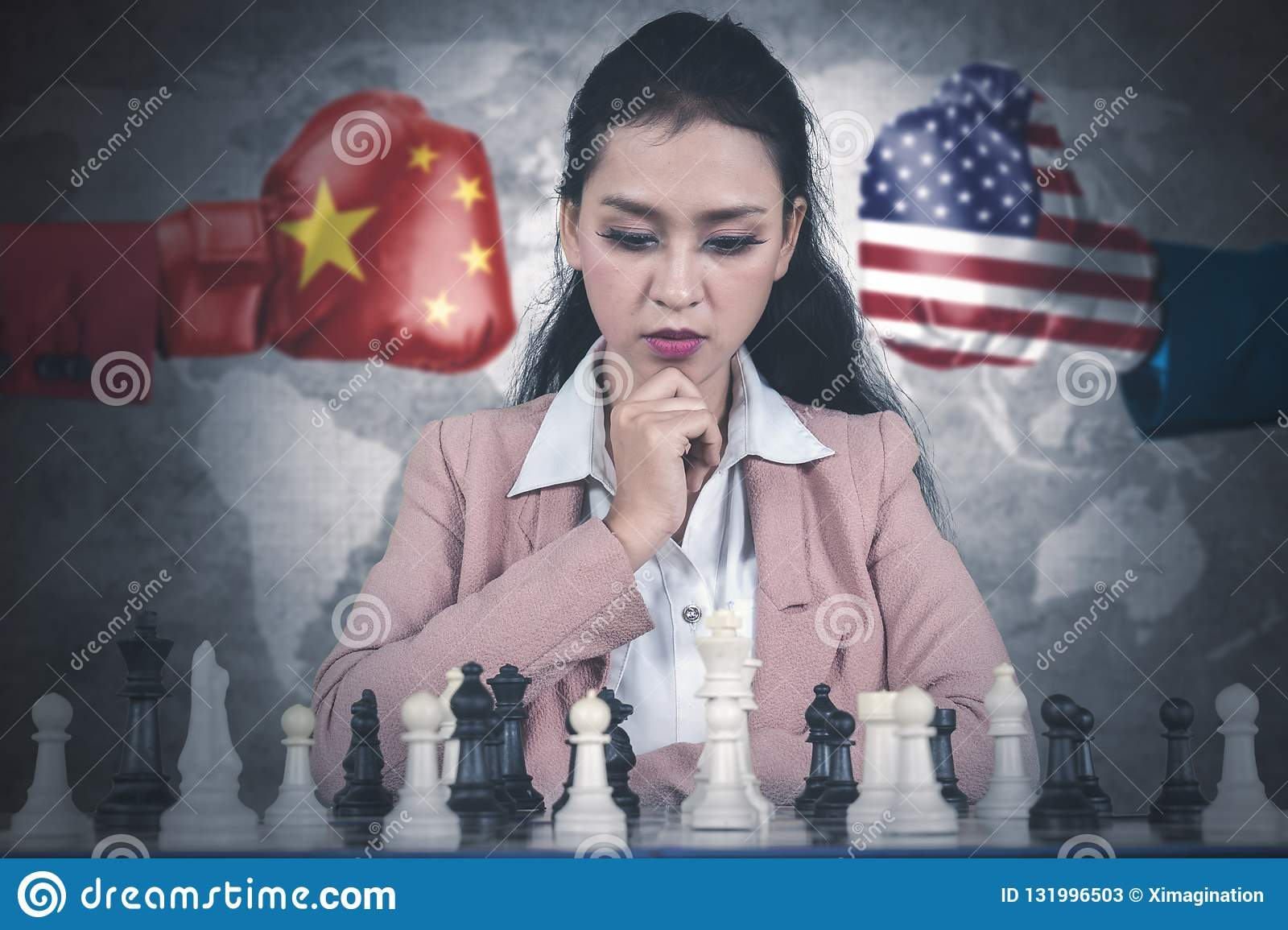 Business woman playing chess on desk
