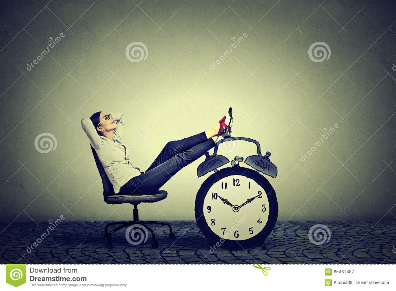 Business woman relaxing sitting in office. Stress free time management concept