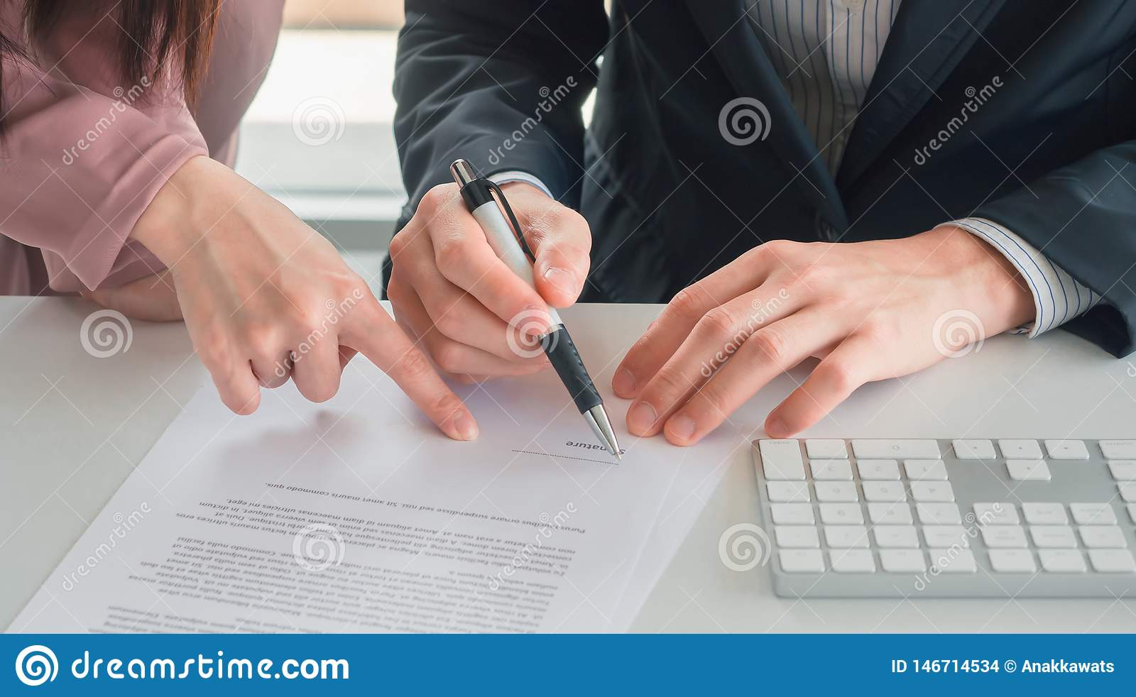 Business woman send document to businessman for signature on his desk