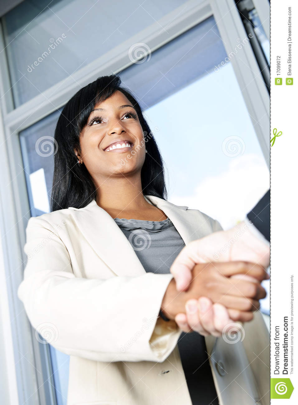 Business woman shaking hands