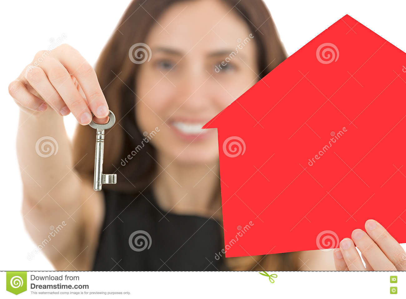 Business woman showing a key for a home for sale
