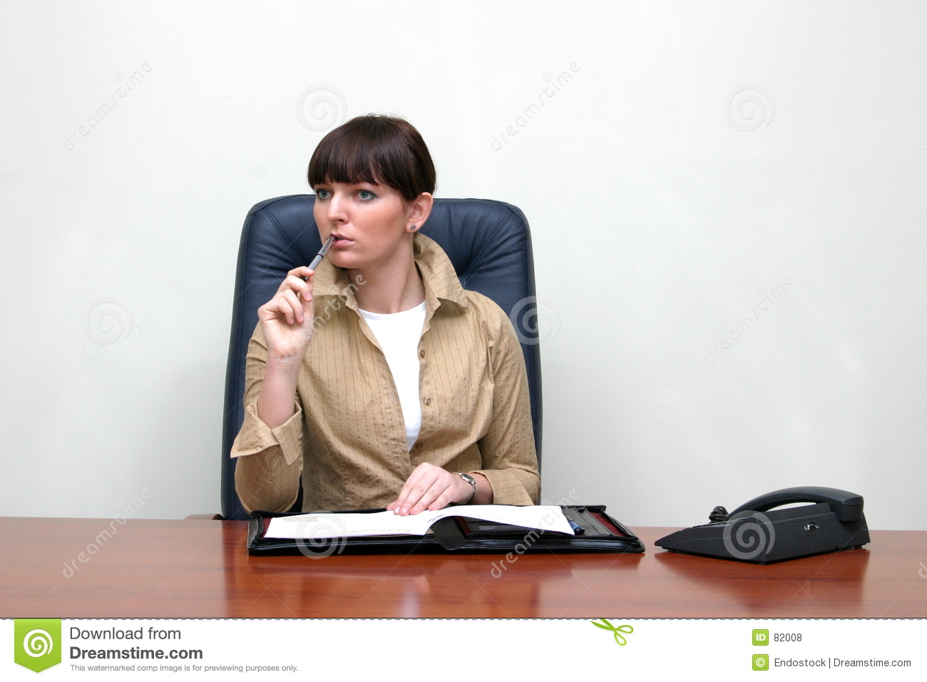 Business Woman Sitting Behind The Desk In The Office, Solving The ...