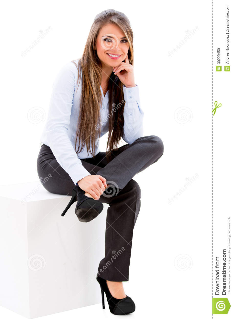 Business woman sitting on a box - isolated over a white background.