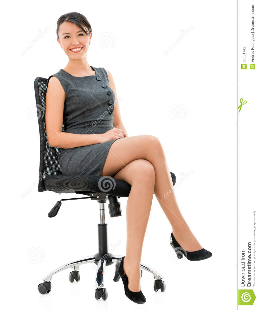 Young woman in the torn stockings sits on a chair