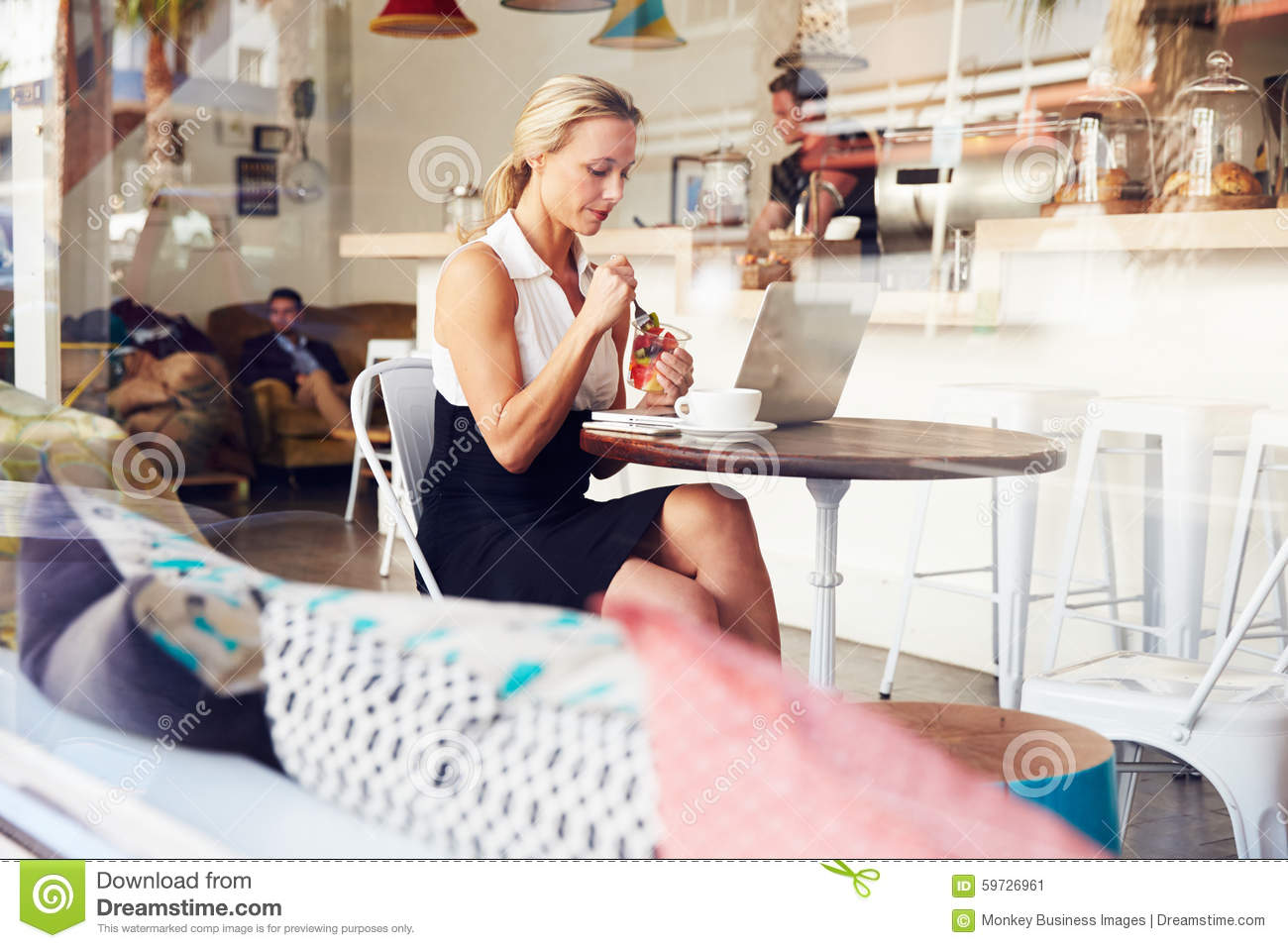 Business Woman Sitting At A Table In Small Coffee Shop Stock Image ... e1fb2ce0f