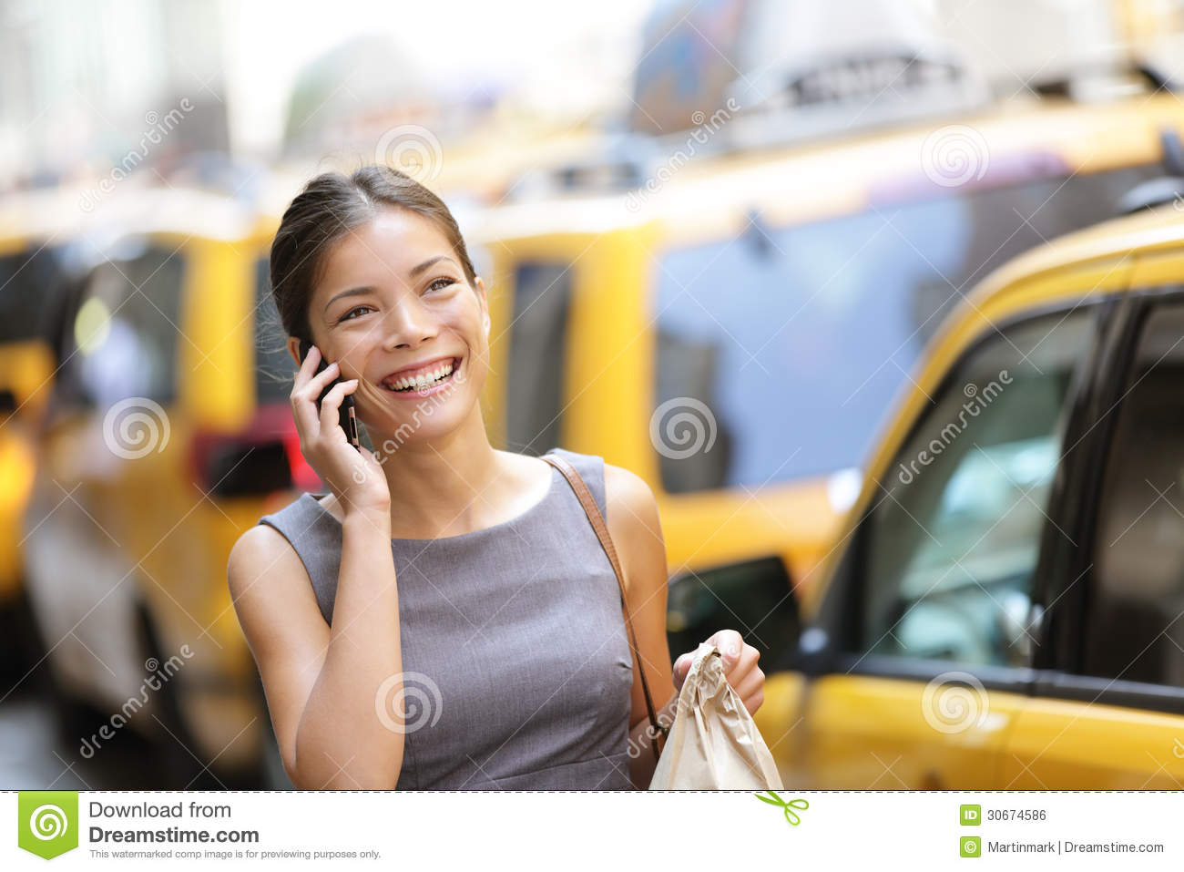 Business woman on smart phone in New York City