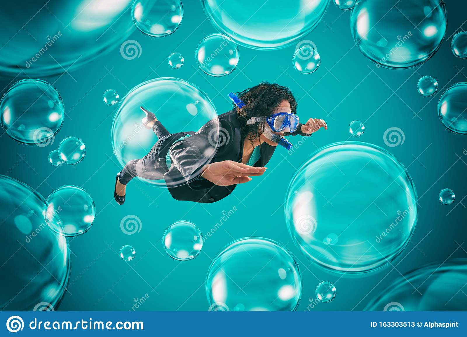 Woman swimming among air bubbles with mask and snorkel in a deep turquoise background