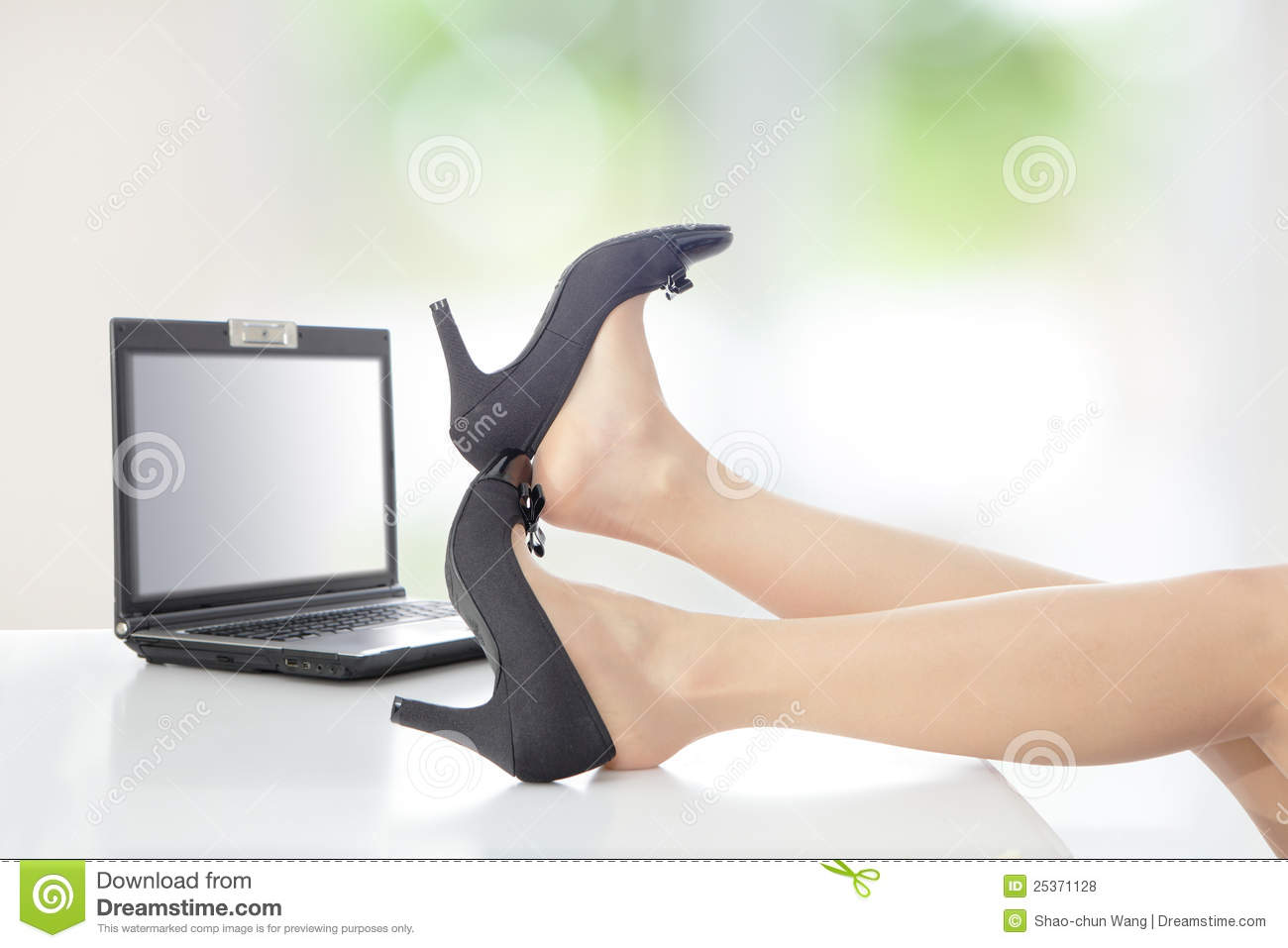 Business Woman Take Off Her High Heels Shoes Royalty Free