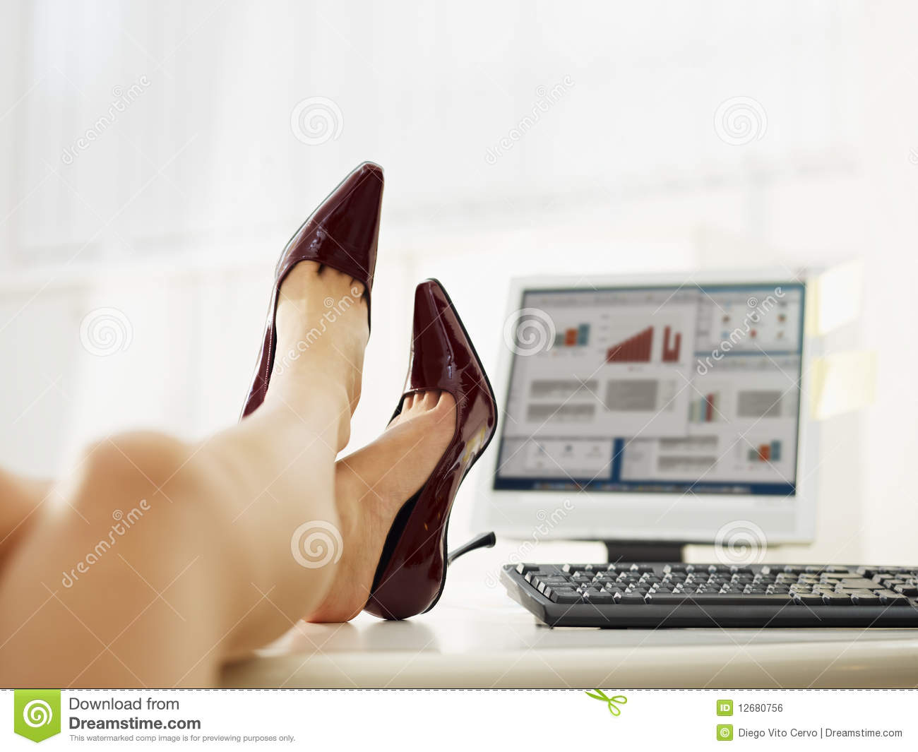 business woman taking off shoes stock photo - image: 12643730