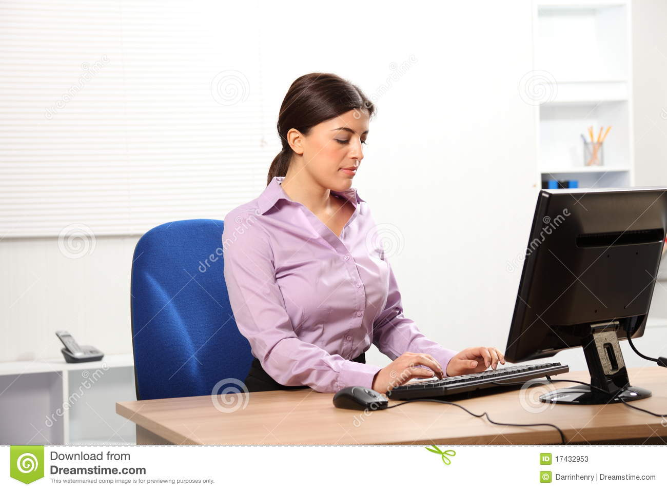 Business Woman Typing At Computer In Office Stock Photos