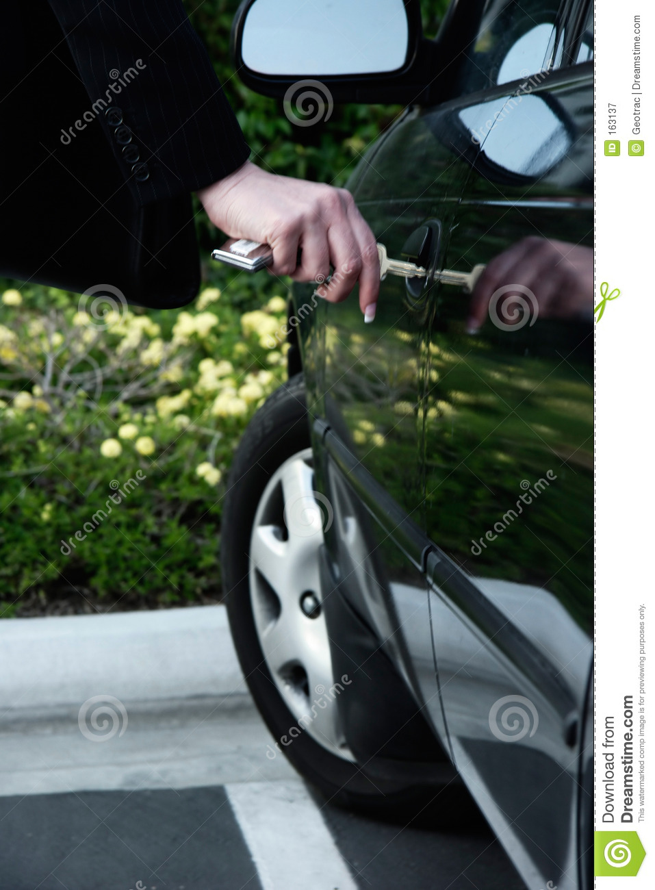 Business woman unlocking car