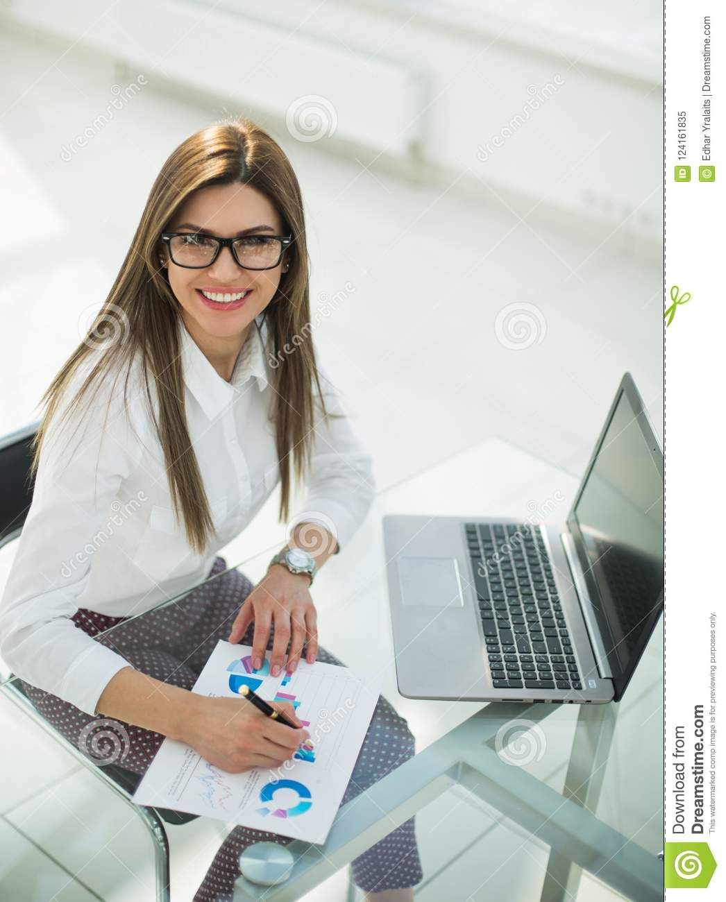 Business woman working by checking financial report