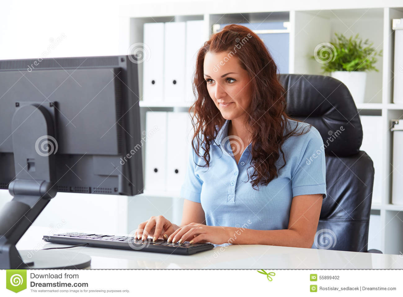 Business woman writing on a computer
