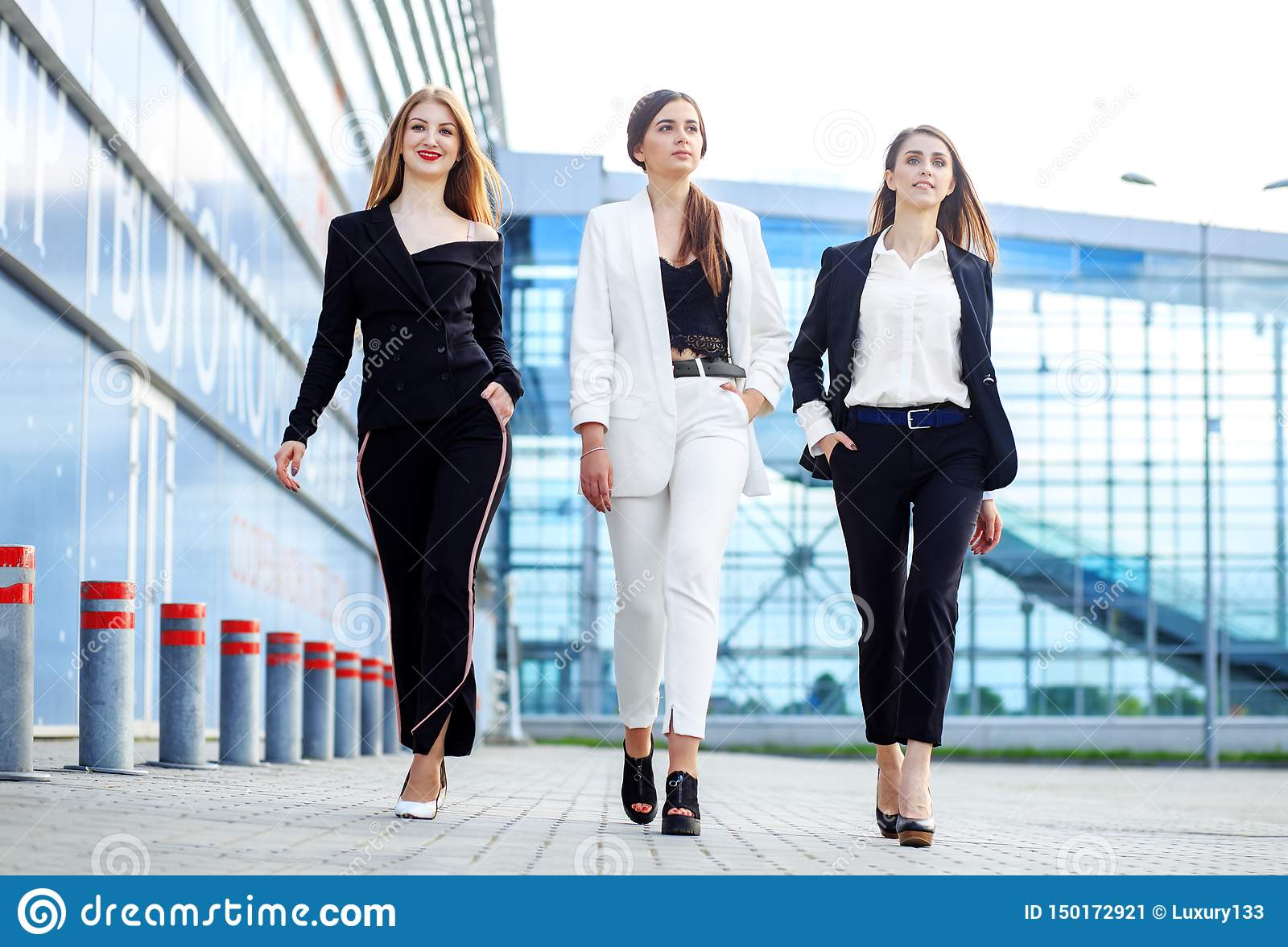 Business women go to the office center. Concept for business, boss, robot, team and success