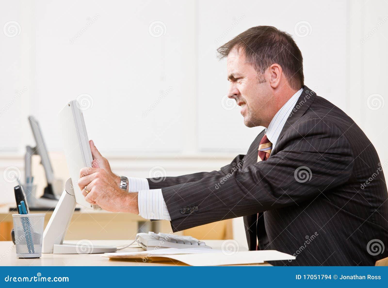 businessman adjusting computer monitor stock images