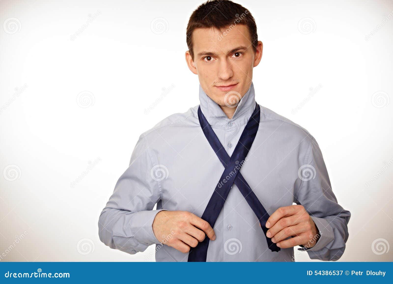 Businessman adjusts a tie