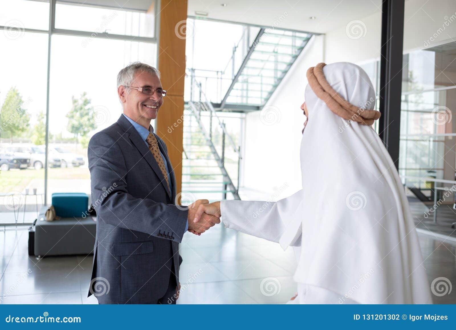 Businessman And Arabian Partner Handshake Stock Photo