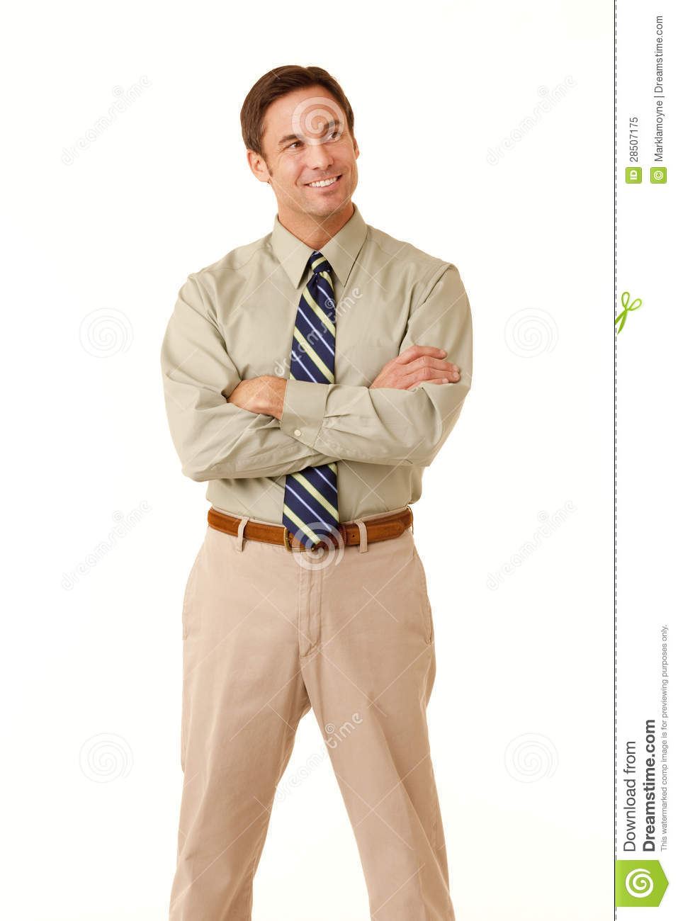Businessman with arms crossed looking off