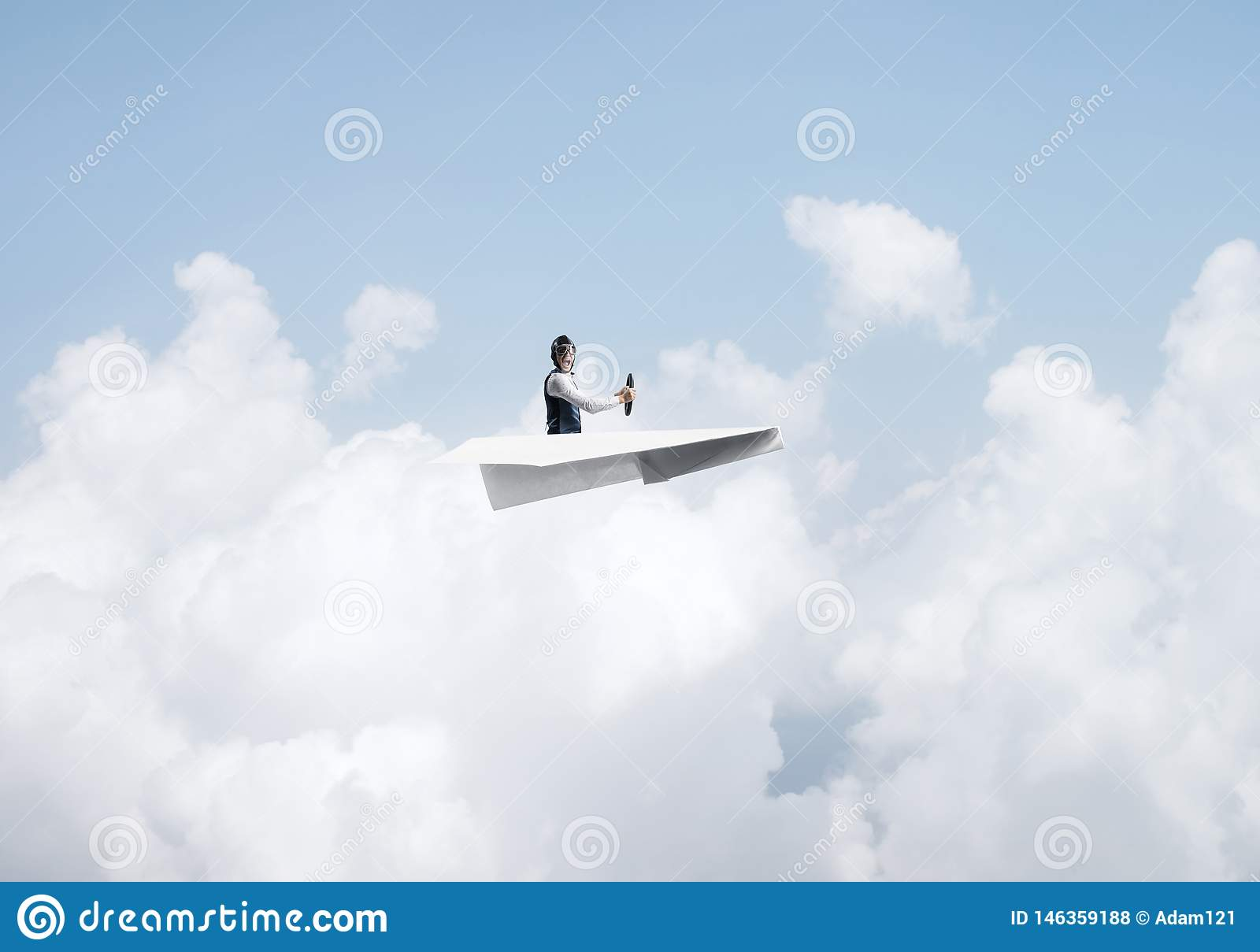 Businessman in aviator hat sitting in paper plane
