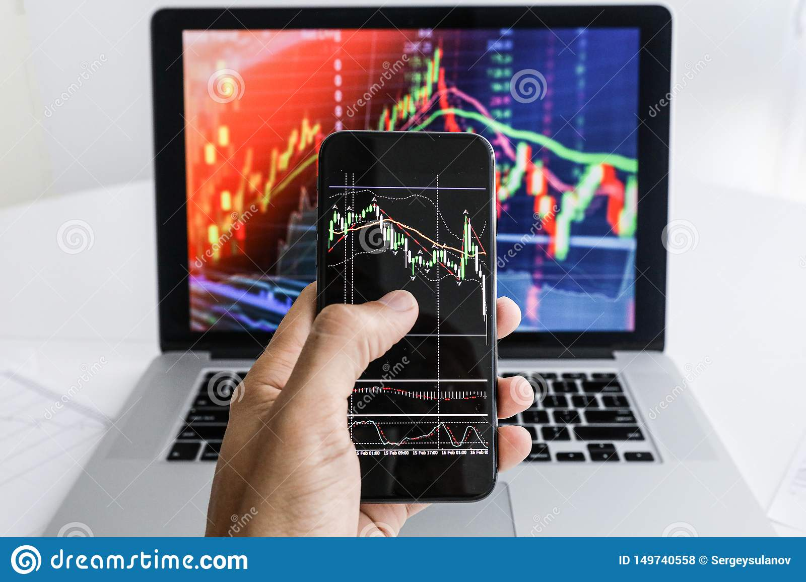 Businessman on the background of laptop phone