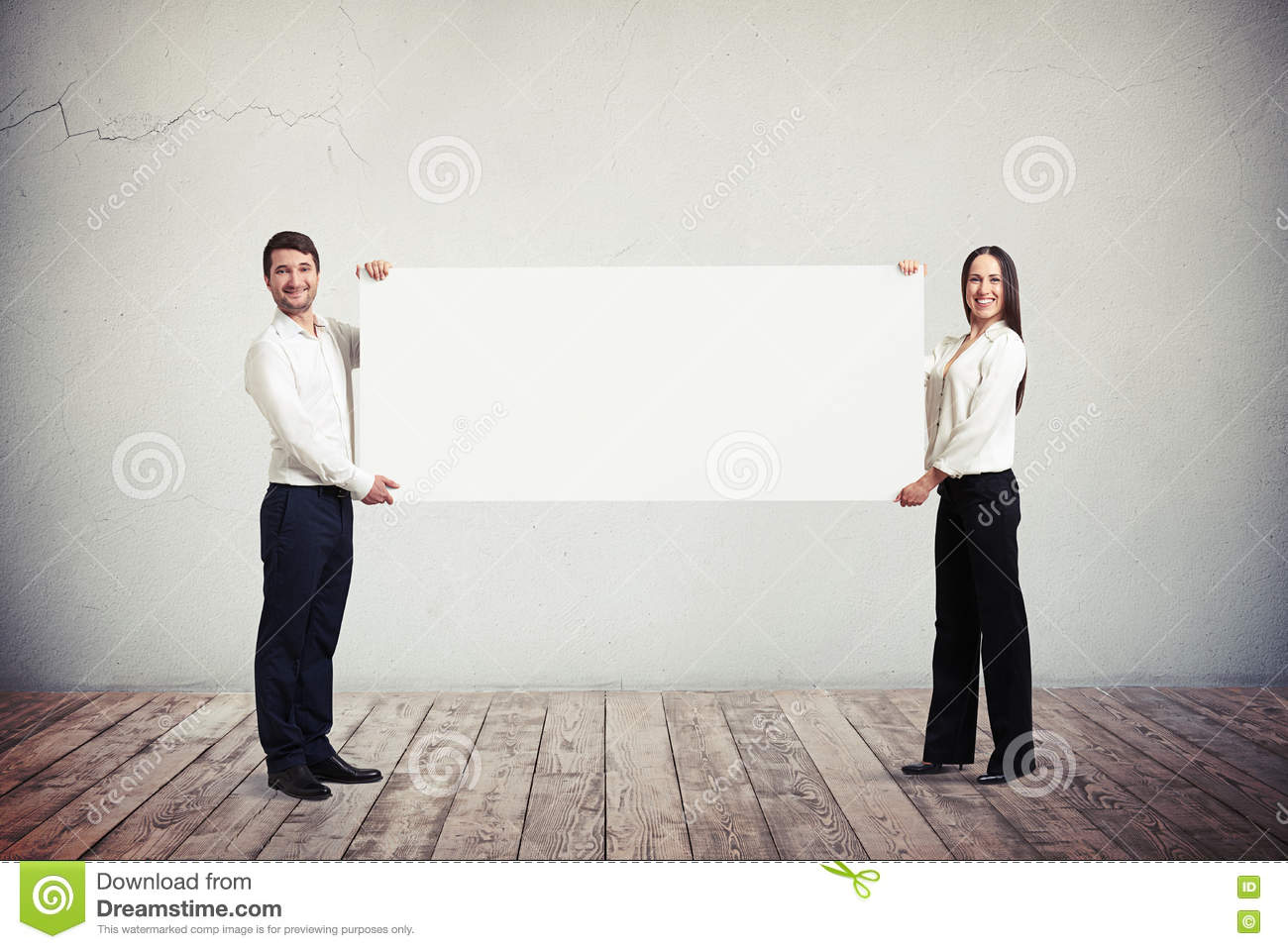 Businessman and businesswoman holding blank horizontal white ban