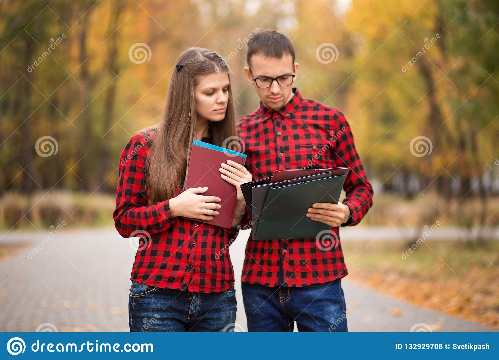 Businessman and businesswoman partner consulting and discussing outdoor